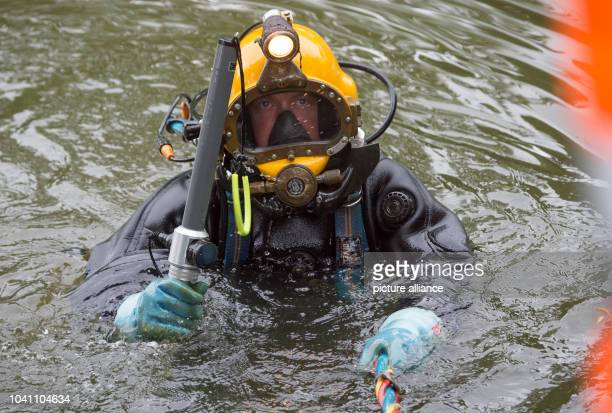 Munitions diver Krister Josepheit dives for munitions in the historical moat in Schwalmstadt, Germany, 30 May 2016. Retreating German troops used the...