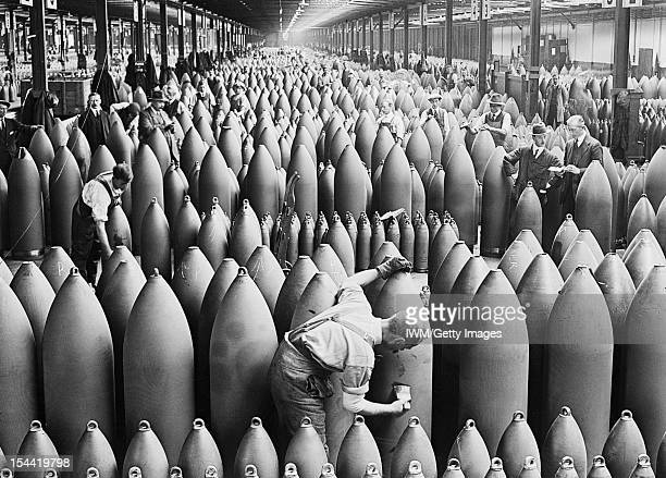 Munitions Production On The Home Front During The First World War, Chilwell, Nottinghamshire, c. 1917, Munition workers painting shells at the...