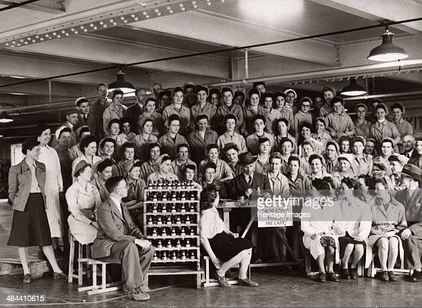 Munitions work County Industries York Yorkshire 1943 A group photo of the staff of County Industries filling the last fuse