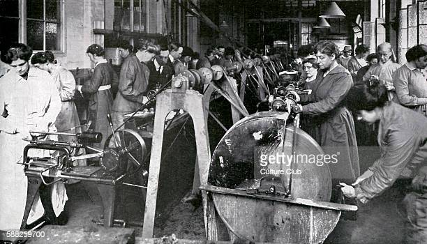 Munitions Workers during World War 1 April 1916 Women learning to use machinery at Shoreditch Technical Institute London