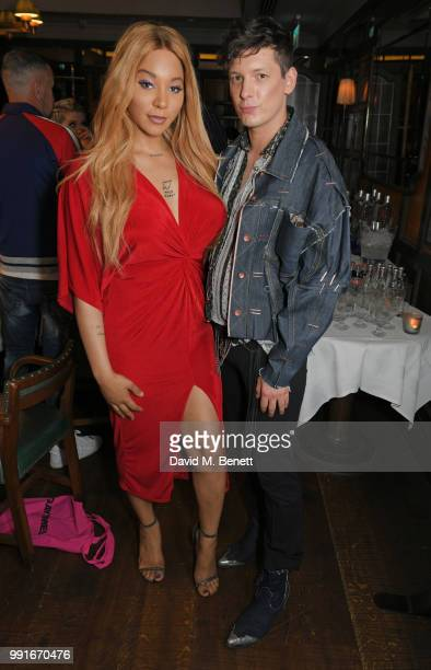 Munroe Bergdorf and Damon Baker attend the Gay Times dinner hosted by Kyle De'Volle at The Ivy Market Grill on July 4, 2018 in London, United Kingdom.
