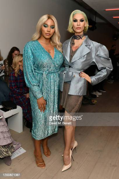 Munroe Bergdorf and Miss Fame attend the Matty Bovan show during London Fashion Week February 2020 at the BFC Show Space on February 14, 2020 in...
