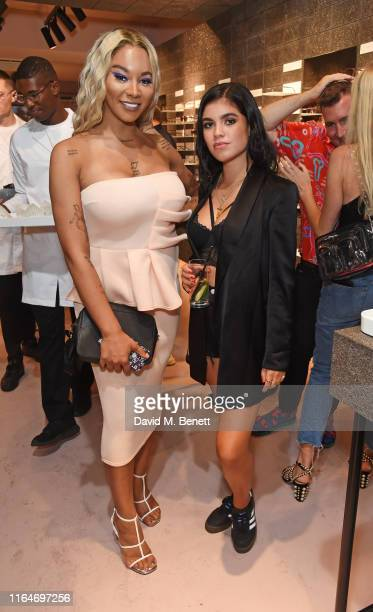 Munroe Bergdorf and Molly Moorish attend the VIU London Store launch on August 29 2019 in London England