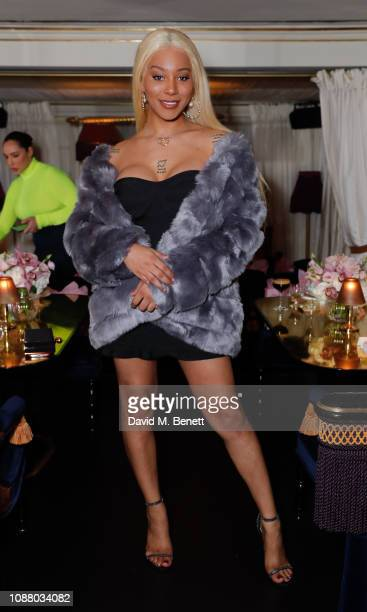 Munroe Bergdorf attends a VIP dinner celebrating the Maya Jama x PrettyLittleThingcom collaboration at Park Chinois on January 24 2019 in London...