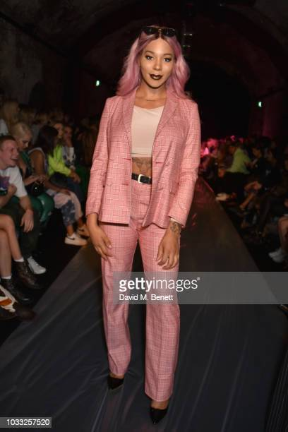 Munroe Bergdorf attends the Ashley Williams front row during London Fashion Week September 2018 at House of Vans on September 14 2018 in London...