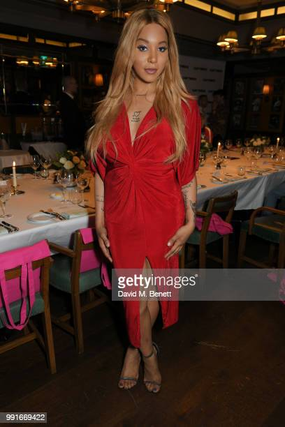 Munroe Bergdorf attends the Gay Times dinner hosted by Kyle De'Volle at The Ivy Market Grill on July 4 2018 in London United Kingdom