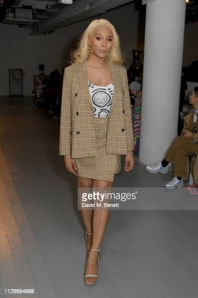 Munroe Bergdorf attends the Matty Bovan show during London Fashion Week February 2019 at the BFC Show Space on February 15 2019 in London England