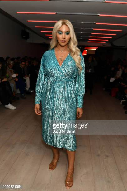 Munroe Bergdorf attends the Matty Bovan show during London Fashion Week February 2020 at the BFC Show Space on February 14 2020 in London England