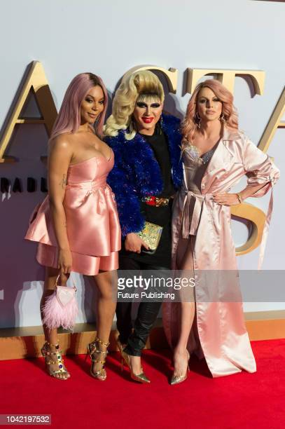 Munroe Bergdorf Jodie Harsh and Courtney Act attend the UK film premiere of 'A Star Is Born' at Vue West End in London September 27 2018 in London...