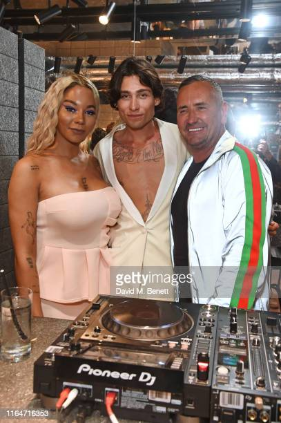Munroe Bergdorf Kyle De'Volle and DJ Fat Tony attend the VIU London Store launch on August 29 2019 in London England