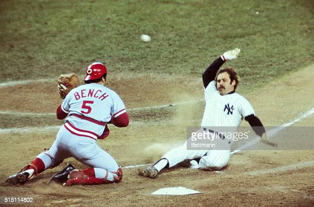 Munson scores Yanks' first run in 1st inning, as ball gets away from Bench. Munson scored from 1st on double by Chris Chambliss.