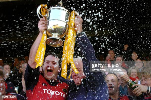 Munster captain Anthony Foley and manager Alan Gaffney celebrate with the Celtic Cup after beating Llanelli Scarlets