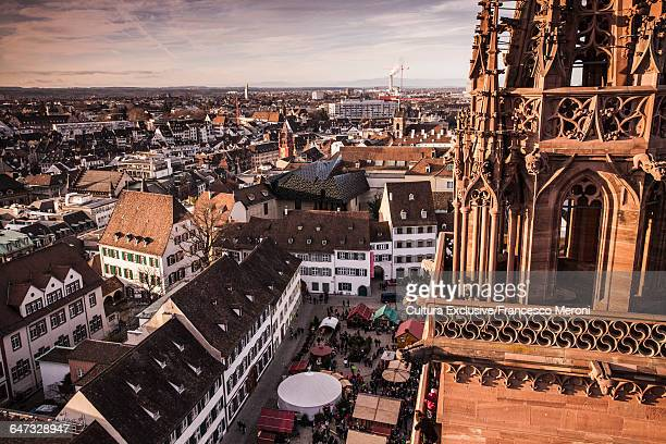 Munster church spire and high angle view of Christmas market, Basel, Switzerland