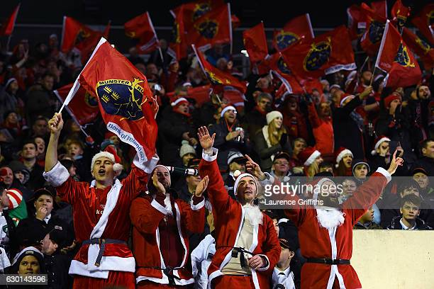 Munster fans dressed as Santa sing during the European Rugby Champions Cup match between Leicester Tigers and Munster Rugby on December 17 2016 in...