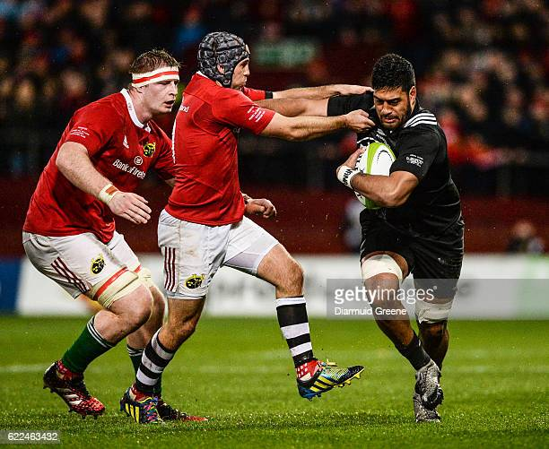 Munster Ireland 11 November 2016 Akira Ioane of Maori All Blacks is tackled by Duncan Williams of Munster supporter by team mate John Madigan left...