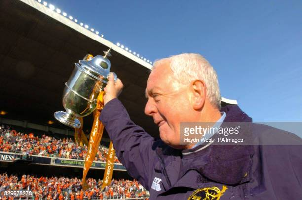 Munster manager Alan Gaffney shows the Celtic Cup to fans after beating Llanelli Scarlets