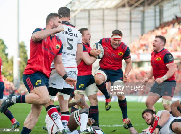 Munster players celebrate after CJ Stander's try during the European Rugby Champions Cup QuarterFinal match between Munster Rugby and Toulouse at...