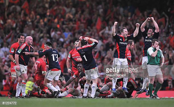 Munster players celebrate as referee Nigel Owens signals the end of the match during the Heineken Cup Final between Munster and Toulouse at the...