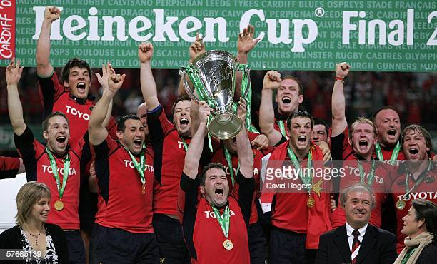 Munster Players celebrate as their Captain Anthony Foley lifts the Trophy following victory during the Heineken Cup Final between Munster and...