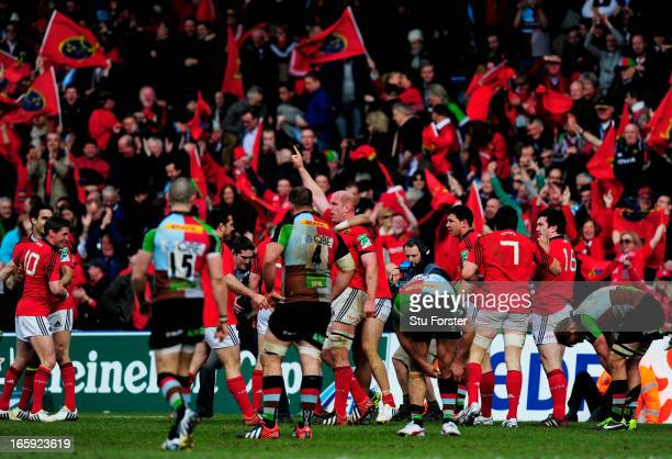 Munster players celebrate their team's victory as the final whistle blows during the Heineken Cup quarter final match between Harlequins and Munster...