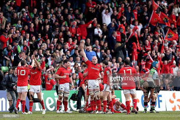 Munster players celebrate their victory as the final whistle blows during the Heineken Cup quarter final match between Harlequins and Munster at The...