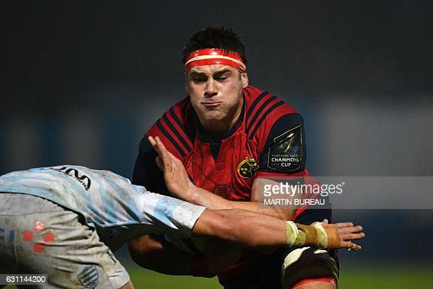 Munster Rugby's flanker Peter O'Mahony tries to break through Racing 92's defence during the European Champions Cup rugby union match between Racing...