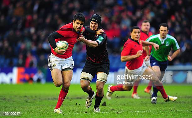 Munster scrum half Conor Murray breaks the tackle of Stuart McInally during the Heineken Cup Round 5 match between Edinburgh and Munster at...