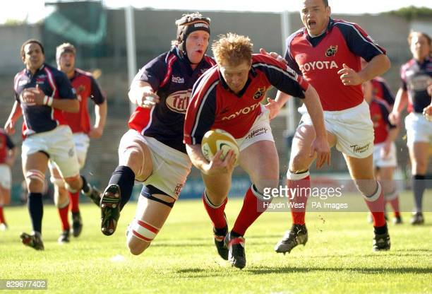 Munster's Anthony Horgan on the way to scoring the opening try against the tackle by Llanelli Scarlets' Simon Easterby
