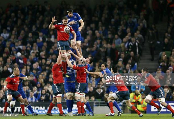 Munster's Dave Foley is challenged by Leinster's Kevin McLaughlin during the RaboDirect PRO12 match at the Aviva Stadium Dublin Ireland