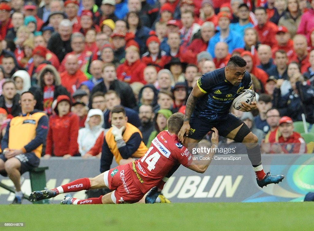 Munster's Francis Saili is tackled by Scarlets' Liam Williams during the Guinness PRO12 Final match between Munster and Scarlets at the Aviva Stadium on May 27, 2017 in Dublin, Ireland.