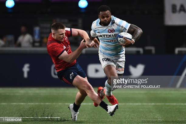 Munster's Irish centre Rory Scannell vies with Racing 92's New Zealand-born French centre Virimi Vakatawa during the European Champions Cup rugby...