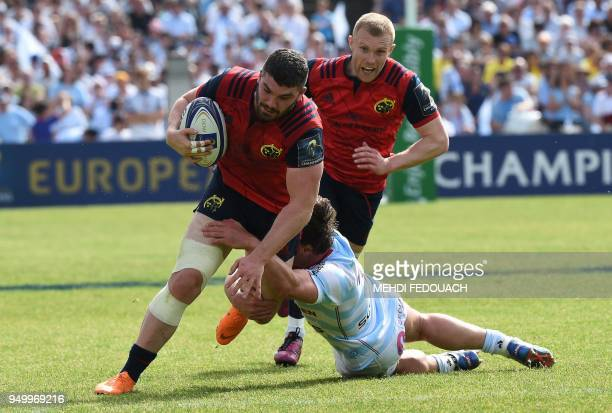 Munster's Irish centre Sammy Arnold is tackled during the European Champions Cup semifinal rugby union match between Racing 92 and Munster on April...
