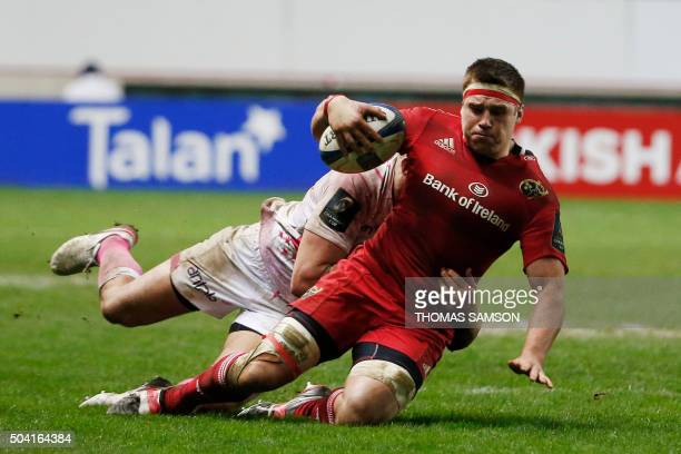 Munster's Irish flanker Robin Copeland is tackled during the European Champions Cup rugby union match between Stade Francais and Munster Rugby on...