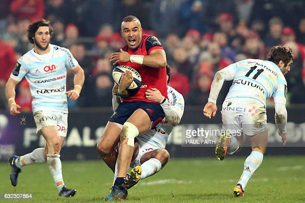 Munster's Irish fullback Simon Zebo is tackled during the European Rugby Champions Cup pool 1 rugby union match between Munster and Racing 92 at...