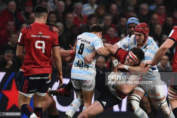 Munster's Irish hooker Niall Scannell vies with Racing 92's French scrumhalf Teddy Iribaren during the European Champions Cup rugby union match...
