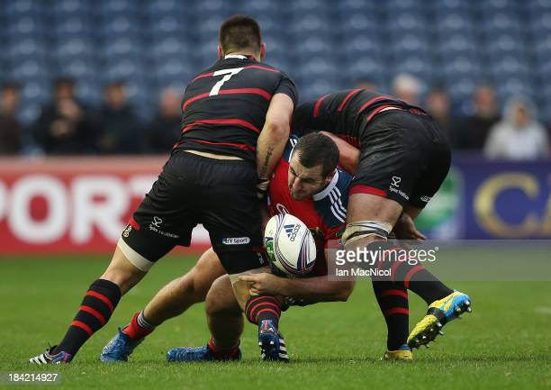 Munster's James Cronin is tackled by Cornell Du Preez and Sean Cox and during the The Heineken Cup Pool 6 Match between Edinburgh and Munster at...