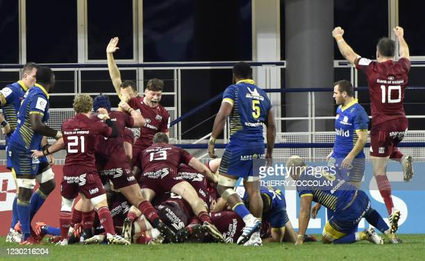 Munster's players celebrate after a try during the European Rugby Champions Cup rugby union match between Clermont and Munster at the Michelin...