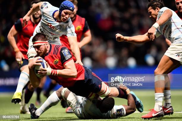 Munster's South African lock Jean Kleyn scores a try during the European Champions Cup rugby union match between Racing 92 and Munster on January 14...
