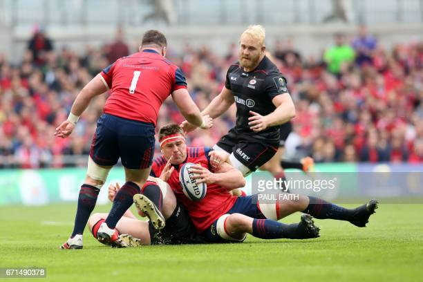 Munster's South Africanborn Irish number 8 CJ Stander holds onto the ball against Saracens in the rugby union European Champions Cup semifinal match...