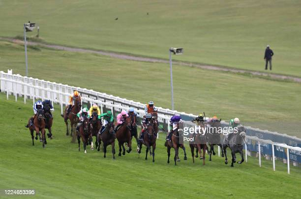 Muntadab ridden by Ben Curtis wins the Investec Zebra Handicap at Epsom Racecourse on July 04, 2020 in Epsom, England. The famous race meeting will...