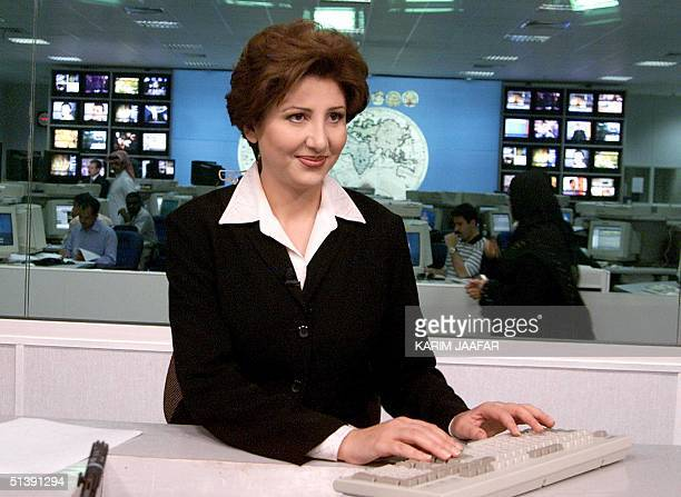 Muntaha alRumahi television announcer and presenter for the Qataribased AlJazeera television channel seen in the Doha studios 13 October 2001...