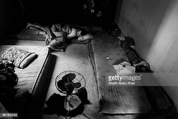 Muntaser a young Iraqi refugees sleeps on the floor in apartment shared with 6 other refugees August 18 in the area of Sad elBousharya Beirut The...