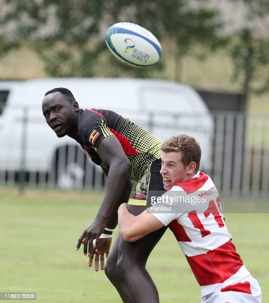 Munyani Ian of Uganda challenged by Rodber Zac of Mauritius during the 2019 Rugby Africa Mens 7s match between Uganda and Mauritius at the Bosman...