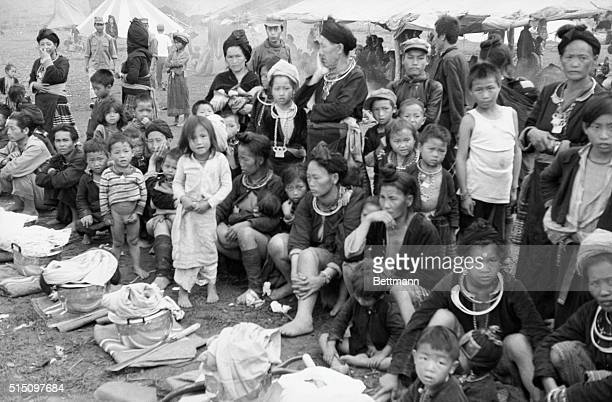 Flight For Life Women and children of the Meo tribes sit weary with exhaustion after their long journey of flight from the proCommunist Pathet Lao...