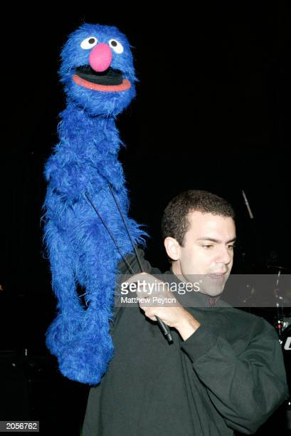 Muppet Grover and an unidentified 'helper' perform at the Sesame Street Workshop 35th Anniversary Gala Cipriani June 4 2003 in New York City