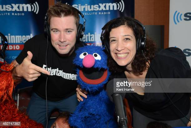 Muppet puppet Grover poses with radio hosts Matt Bean and Jessica Shaw after being interviewed on SiriusXM's Entertainment Weekly Radio channel from...