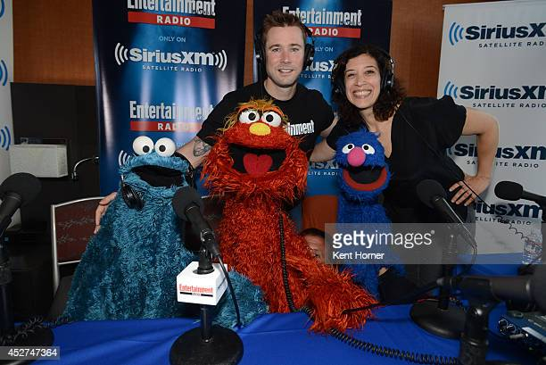 Muppet puppets Cookie Monster Murray and Grover Grover pose with radio hosts Matt Bean and Jessica Shaw after being interviewed on SiriusXM's...