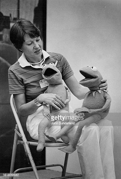MAY 23 1980 MAY 24 1980 Muppetry Mari Kaestle left designer of Muppet exhibition at Denver Art Museum holds Kermit the Frog in original and new...