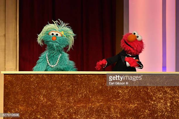 Muppets Rosita and Elmo speak onstage at the 43rd Annual Daytime Emmy Awards at the Westin Bonaventure Hotel on May 1 2016 in Los Angeles California