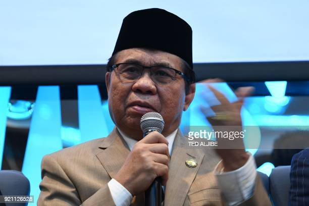 Murad Ebrahim chairman of Moro Islamic Liberation Front gestures as he speaks during a Foreign Correspondents Association of the Philippines forum in...